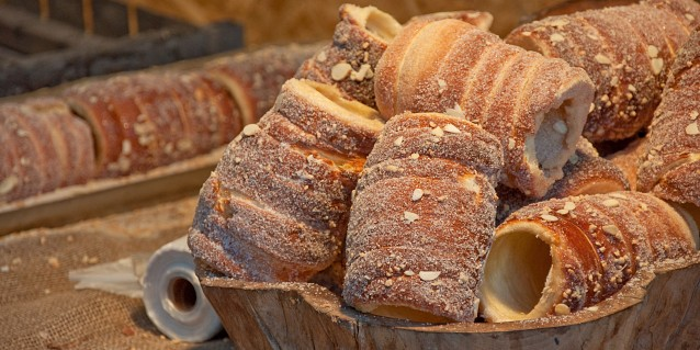 Trdlo or trdelnik - traditional national Czech sweet pastry dough, cooked on an open fire.